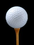 Golf ball. White Golf ball on tee Stock Photos