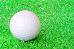 Golf Ball. On A Field With Artificial Grass Royalty Free Stock Photos