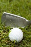 Golf ball. A golf ball waiting to be hit hard with a 3 iron Royalty Free Stock Photos