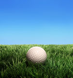 Golf Ball. A golf ball on plastic grass royalty free stock photos