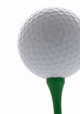 Golf ball. On green tee Royalty Free Stock Photo