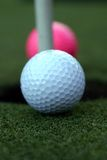 Golf ball. S at the hole Royalty Free Stock Image