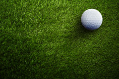 Golf ball. On green field stock images