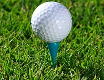 Golf Ball. Up on a tee stock image