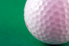Golf Ball. Closup of the dimples of a golf ball (shallow dof Royalty Free Stock Photo