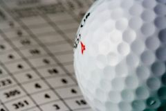 Golf Ball. Close-up of a golf ball on a scorecard (shallow dof Royalty Free Stock Photos