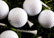 Golf ball. On tee in grass Royalty Free Stock Photography