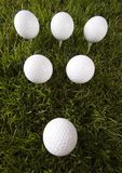 Golf ball. On tee in grass Stock Image