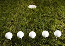 Golf ball. On tee in grass Stock Photo