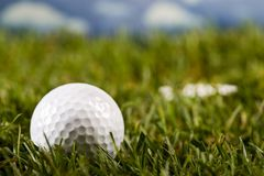 Golf ball. On tee in grass Royalty Free Stock Image