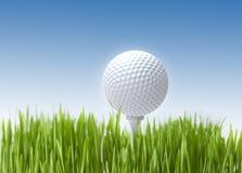 Golf ball. On blue background close up stock photos