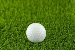 Golf Ball. On the Green Grass Stock Images