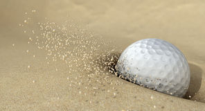 Golf Ball In Action Hitting Bunker Sand Royalty Free Stock Photo