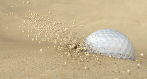 Golf Ball In Action Hitting Bunker Sand. An extreme close up of a golf ball hitting the sand in a bunker and emitting grains of sand forwards Royalty Free Stock Photography