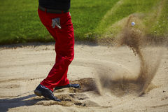 Golf ball in the air in the bunker Stock Image