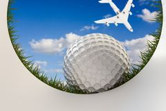Golf ball approaching hole Royalty Free Stock Image