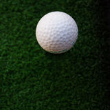 Golf ball on artificial grass Royalty Free Stock Photo