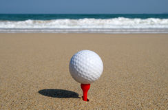 Golf ball on the beach. Golf ball on the beach, ready to be hit in to the ocean Stock Photo