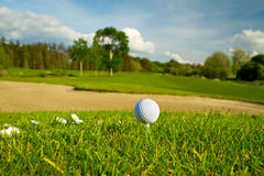 Golf ball on the beautiful golf course. With sandbanks Royalty Free Stock Photo