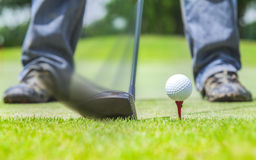 Golf. Ball behind driver at driving range, plenty of copy-space and very shallow depth of field Royalty Free Stock Photo