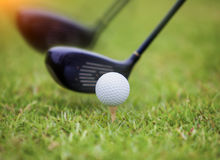 Golf ball behind driver at driving range. Plenty of copy-space and very shallow depth of field Royalty Free Stock Photography