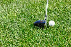 Golf ball behind driver at driving range, plenty o Royalty Free Stock Photography