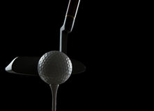 Golf ball on black background Royalty Free Stock Photography