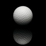 Golf ball on black background Royalty Free Stock Image