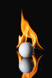 Golf ball on black background with fire Stock Image