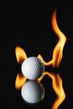 Golf ball on black background with fire. And reflect Royalty Free Stock Photo