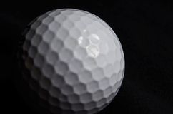 Golf ball on black background Royalty Free Stock Photos