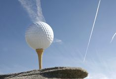 Golf ball with blue sky Stock Photography