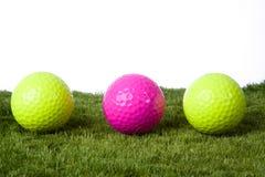 Golf ball boy. Three golf balls in a row Royalty Free Stock Photo