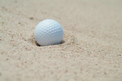 Golf-ball in bunker. Shallow depth of field Stock Images