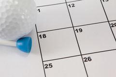 Golf ball by calender date. Close up of golf ball by calender date Royalty Free Stock Photo