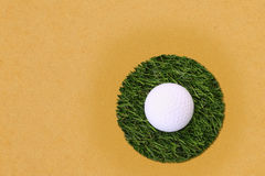 Golf ball on center island grass field Stock Images