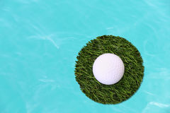 Golf ball on center island grass Royalty Free Stock Images