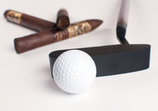 Golf ball and cigars isolated Royalty Free Stock Image