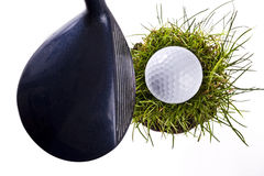 Golf Ball On Clod Of Grass Royalty Free Stock Images
