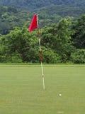 Golf. Ball close to hole Stock Image