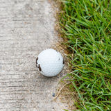 Golf ball. Close up dirty golf ball on the cart path Royalty Free Stock Images