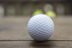 Golf ball. Close up of golf ball on a tee  at sunrise on frosty morning Royalty Free Stock Images