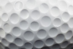 Golf ball. Close up view showing dimples on a golf ball royalty free stock photo