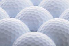 Golf Ball. Closeup of several white golf balls in backlight shot stock photos
