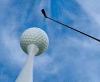 Golf ball. Clouds sky and bright day Stock Photography