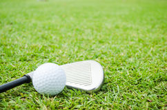 Golf ball with club Stock Photography