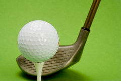 Golf ball and club. In anticipation of play Royalty Free Stock Image