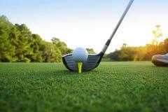 Golf ball and golf club in beautiful golf course at Thailand. Co. Golf ball and golf club in beautiful golf course at sunset background stock images