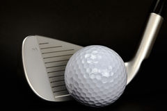 Golf Ball and Club Closeup on Black Background Royalty Free Stock Image