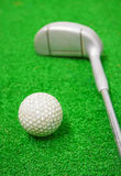 Golf ball and club Stock Photos